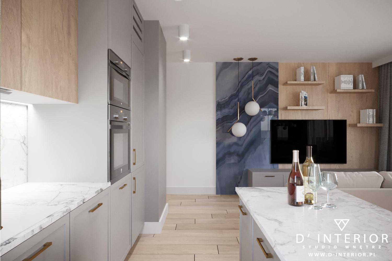 Niewielki salon połączony z kuchnią